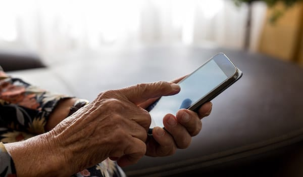 Older man using a smart phone.